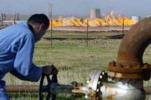 An oil worker tending to a supply pipeline in Iraqi Kurdistan AFP PHOTO