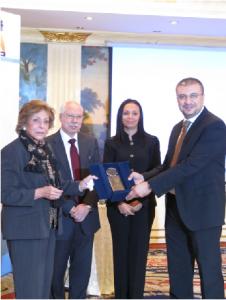 Mervat Tallawy and Amr El-Lethy being honoured for their role in highlighting women's issues. (DNE / Nouran El-Behairy)